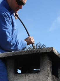 Man Cleaning Chimney, Chimney Sweeps in Ashford, Kent